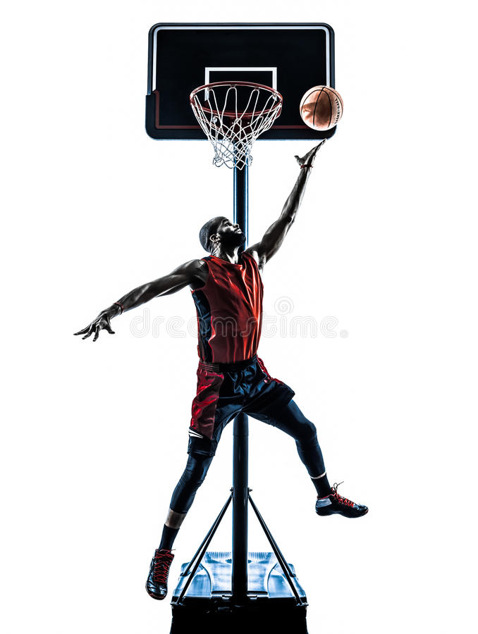 Basketball player jumping throwing silhouette royalty free stock photography