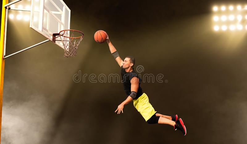 Basketball player makes a throw, shoot in action royalty free stock photo