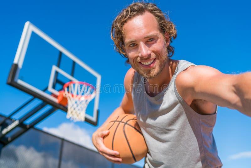 Basketball player man taking fun selfie royalty free stock photography