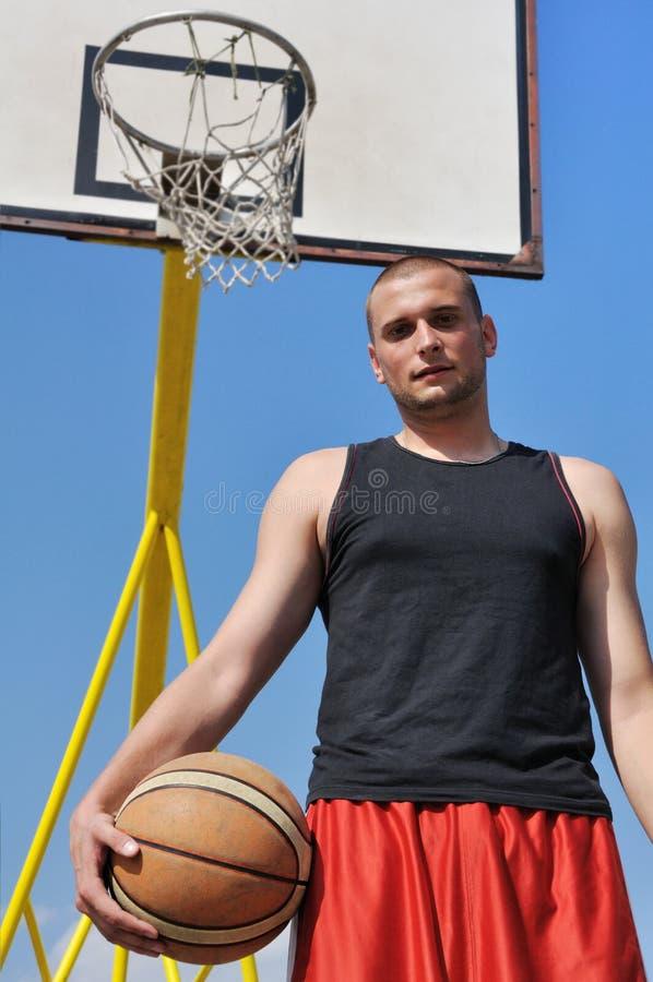 Basketball player posing royalty free stock photography