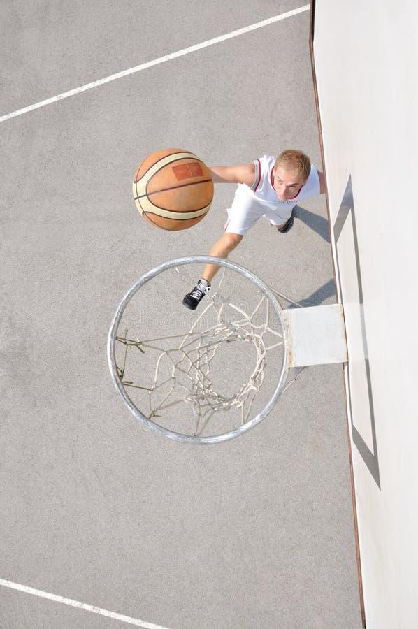 Download Basketball player shooting stock image. Image of court - 23621851