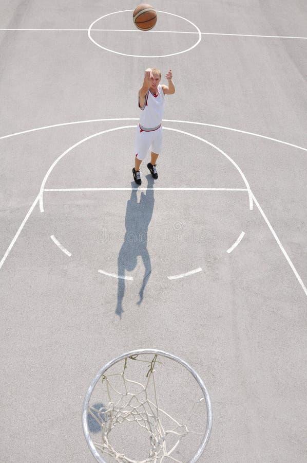 Basketball player shooting stock photography