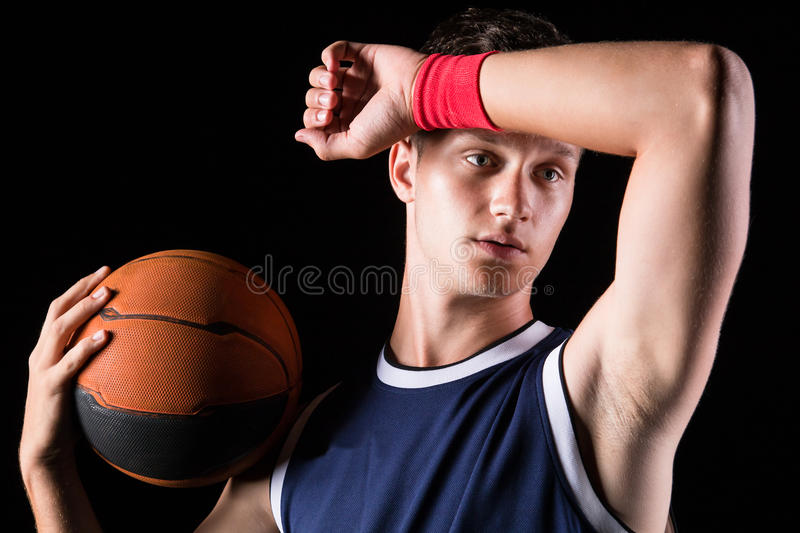 Basketball player wipes the sweat from his forehead stock image