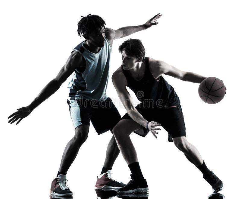 Basketball players men isolated silhouette shadow. Two basketball players men isolated in silhouette shadow on white background royalty free stock photo