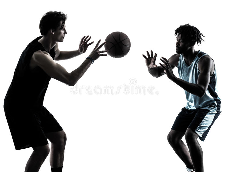 Basketball players men isolated silhouette shadow. Two basketball players men isolated in silhouette shadow on white background stock image