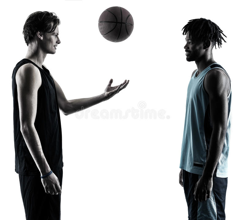 Basketball players men isolated silhouette shadow. Two basketball players men isolated in silhouette shadow on white background royalty free stock photos