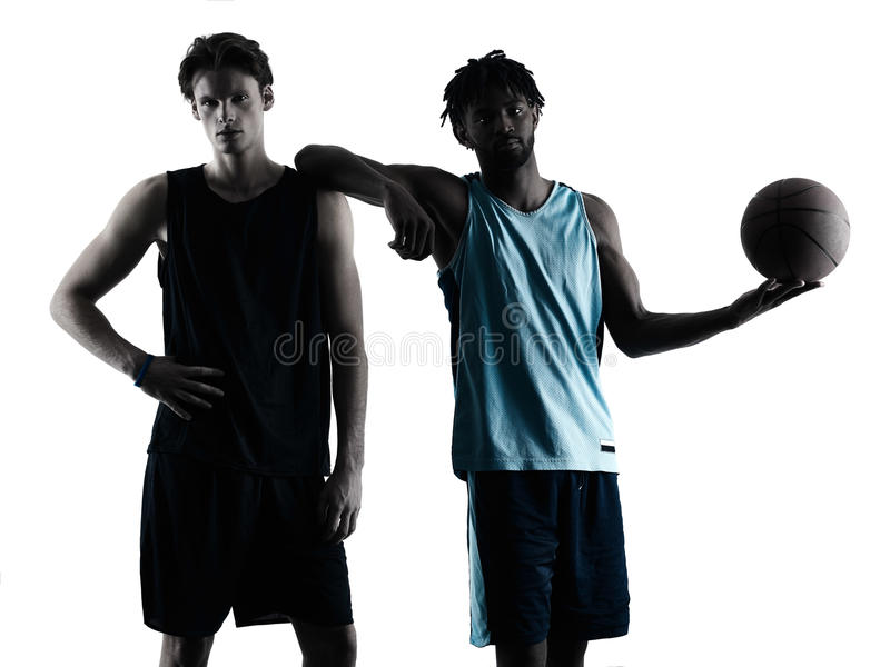 Basketball players men isolated silhouette shadow. Two basketball players men isolated in silhouette shadow on white background royalty free stock photography