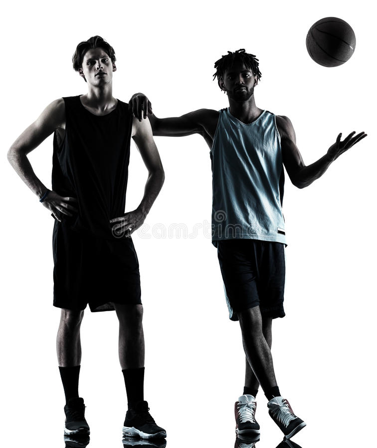 Basketball players men isolated silhouette shadow. Two basketball players men isolated in silhouette shadow on white background stock images
