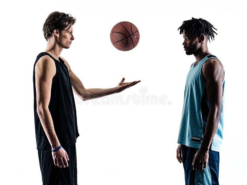 Basketball players men   silhouette shadow. Two basketball players men  in silhouette shadow on white background royalty free stock photography