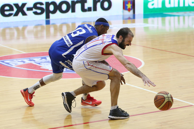 Basketball players. Pankracije Barac and Mohammed Alhaji pictured in action during the game between Steaua CSM Exim Bank Bucharest and BC Mures Targu Mures royalty free stock photos