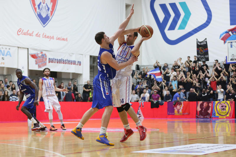 Basketball players. Pictured in action during the game between Steaua CSM Exim Bank Bucharest and BC Mures Targu Mures stock photo