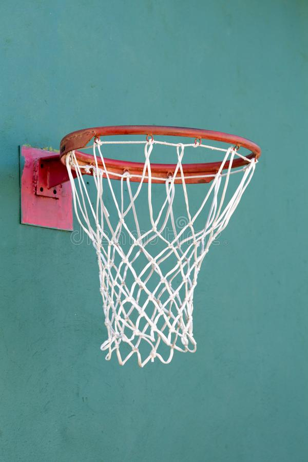 Basketball ring on a stone turquoise wall. Close-up royalty free stock photography