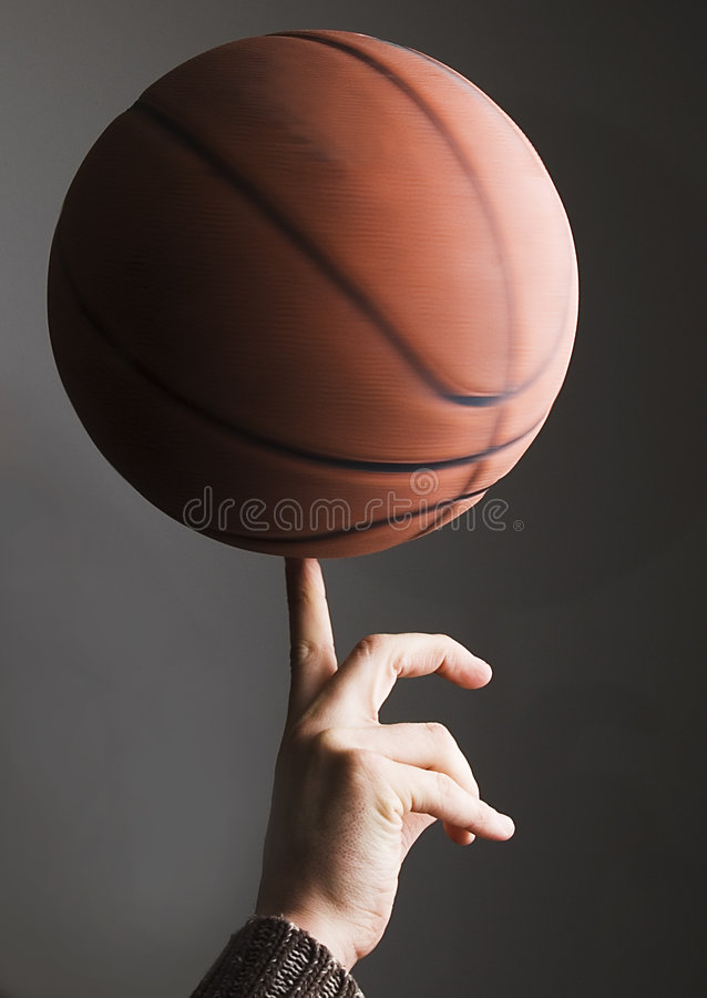 Basketball rolling on finger royalty free stock images