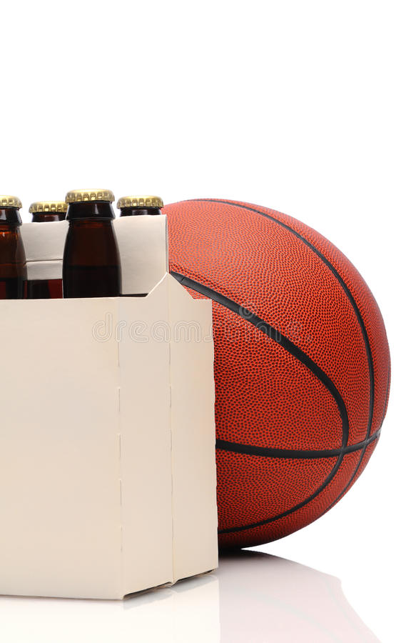 Basketball and six pack of beer stock image