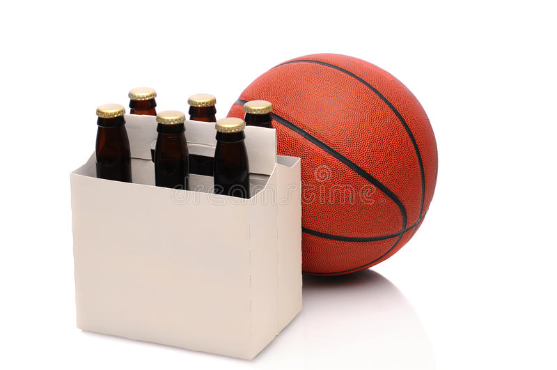 Basketball and six pack of beer stock images
