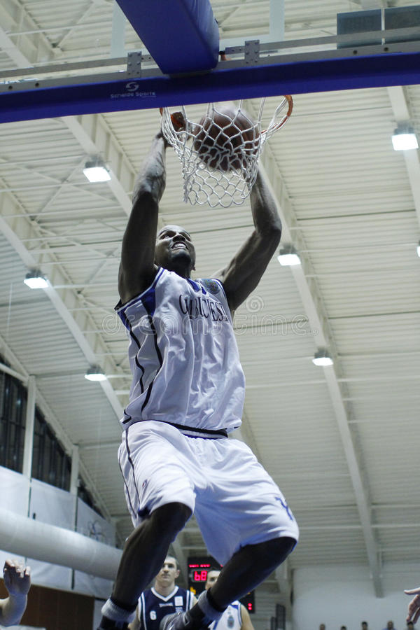 Basketball slam dunk. Chris Ellis (Christian Markell Ellis) from CSM Bucharest scores a slam dunk in a match with CSM Oradea, in Bucharest, saturday, february 6 stock photo