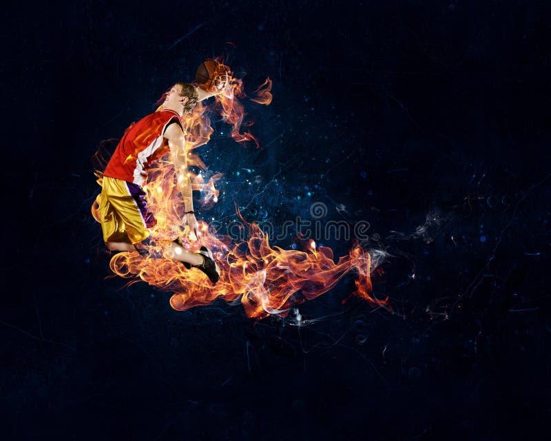 Basketball-Spieler auf Feuer lizenzfreie stockbilder