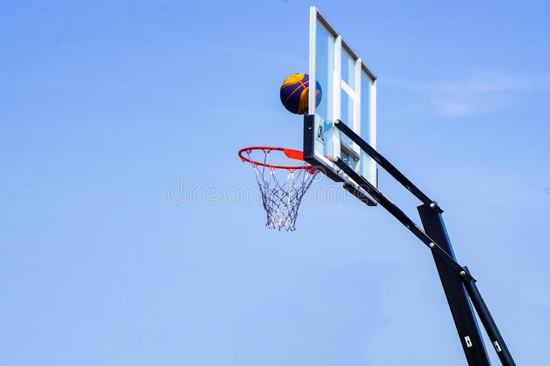 Basketball and street ball with a rack on a blue sky background stock photos