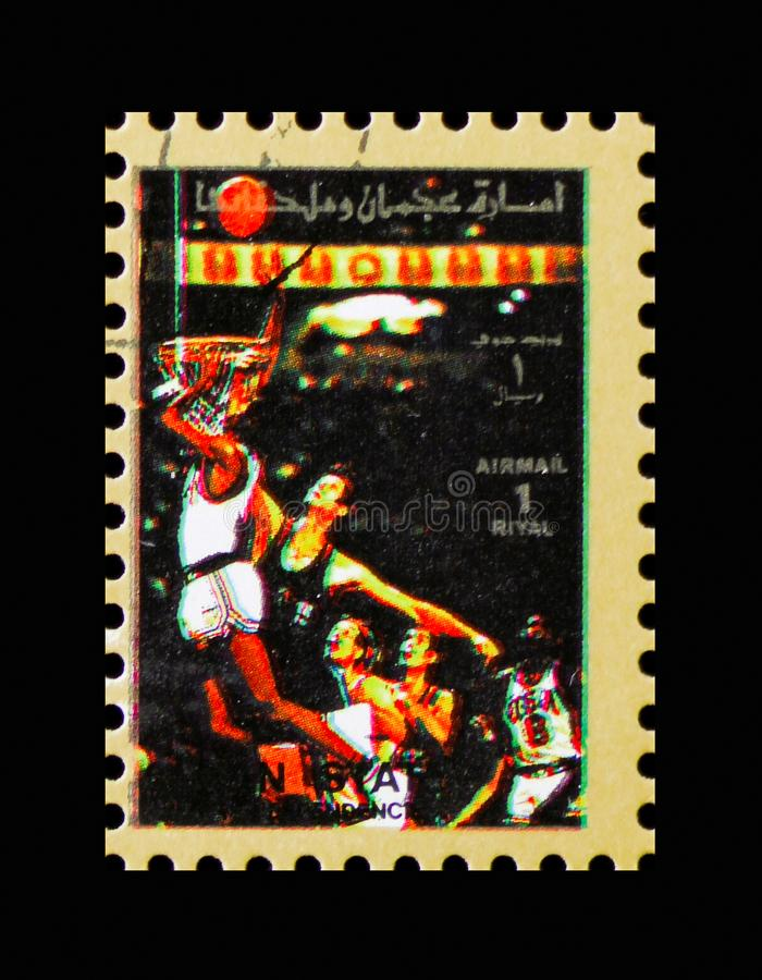 Basketball, Summer Olympics serie, circa 1972. MOSCOW, RUSSIA - NOVEMBER 10, 2018: A stamp printed in Umm al-Qaiwain shows Basketball, Summer Olympics serie stock photography
