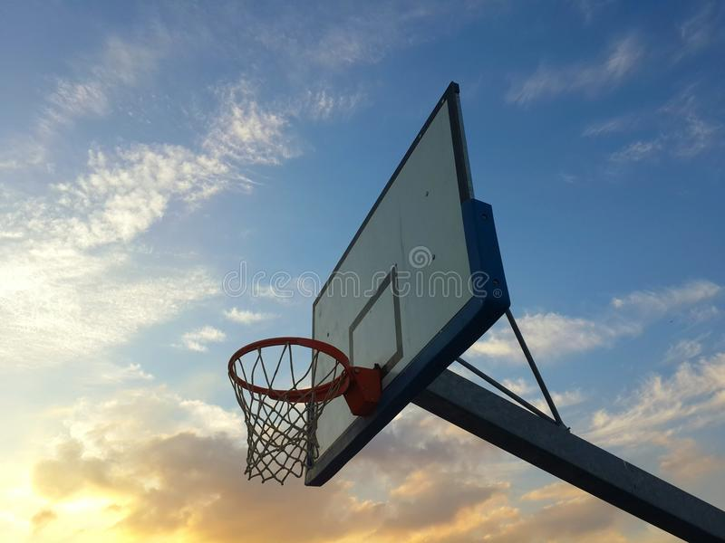 Basketball at sunset stock photo