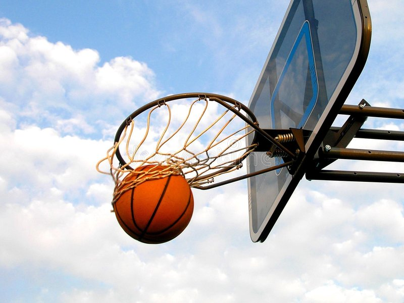 Basketball Swish. A basketball swishes through the hoop royalty free stock images