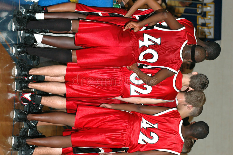Basketball team huddle. Huddle of high school boys basketball team during a time out stock photos