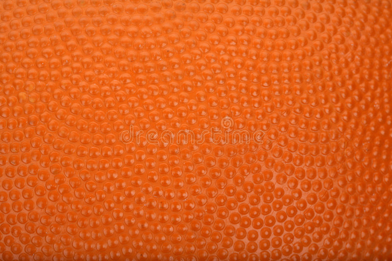 Basketball texture. Detail of a orange basketball texture royalty free stock photography