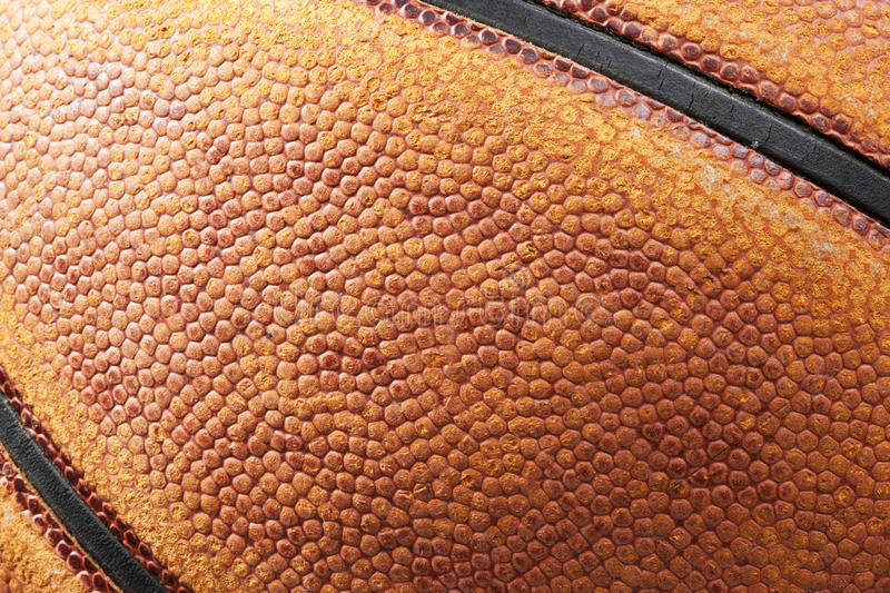 Basketball Texture Background. Closeup of a basketball showing leather texture royalty free stock image