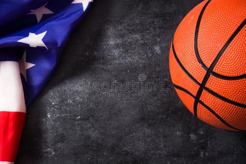 Basketball and USA flag on black slate background. stock photography