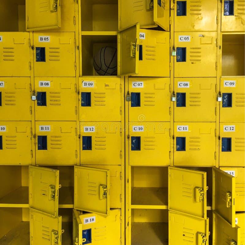 A basketball in yellow locker.Yellow locker design. royalty free stock photography
