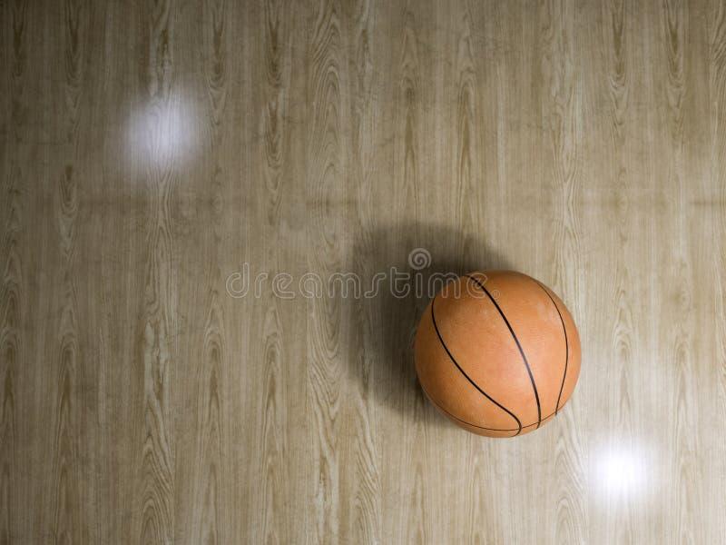 Basketballplatzbretterboden mit Ball auf Schwarzem mit c stockbilder