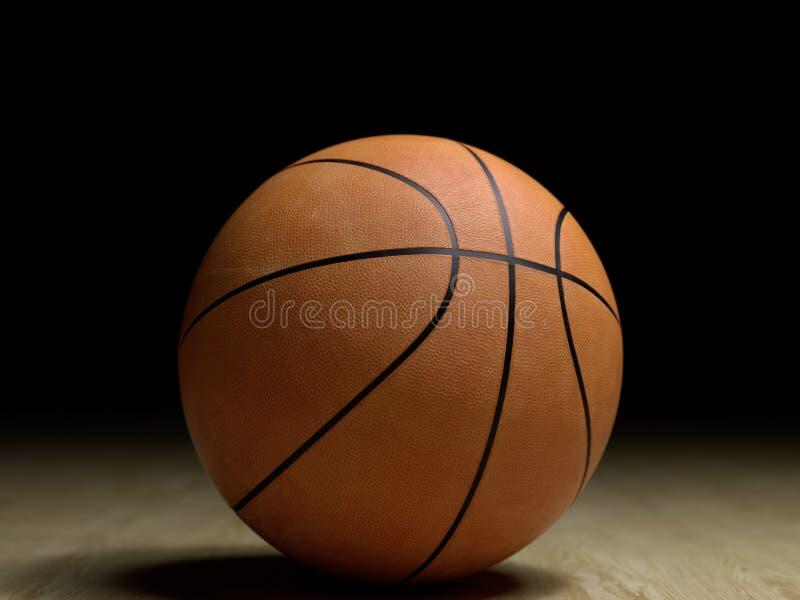 Basketballplatzbretterboden mit dem Ball lokalisiert auf Schwarzem mit c stockfotos