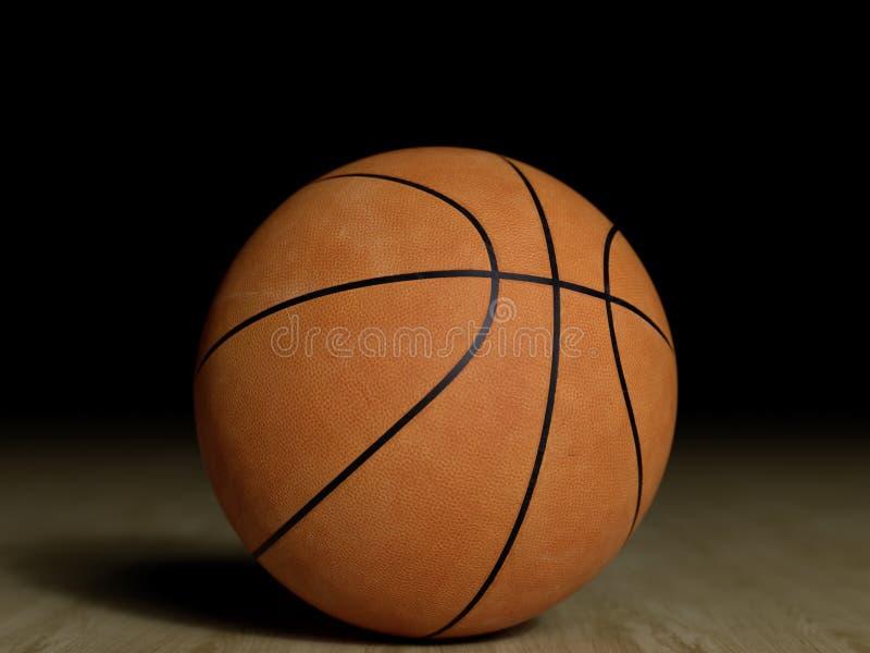 Basketballplatzbretterboden mit dem Ball lokalisiert auf Schwarzem mit c stockfotografie