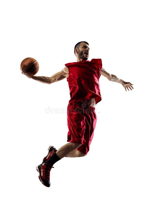 Basketbalspeler in actie op wit wordt geïsoleerd dat stock afbeelding