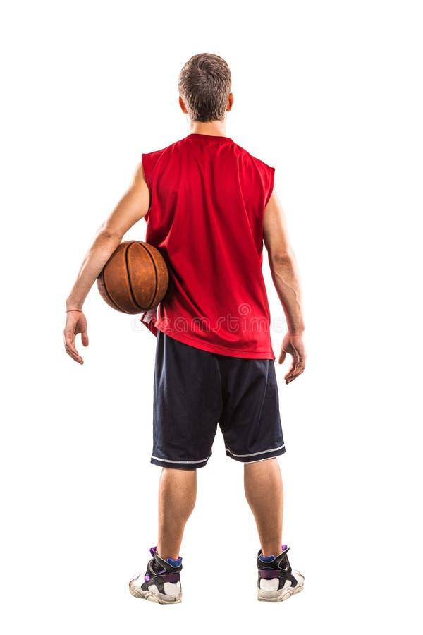 Basketbalspeler die zich met bal van de rug bevinden royalty-vrije stock foto's