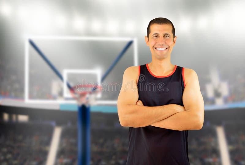 Basketbalspeler het glimlachen royalty-vrije stock afbeelding