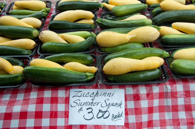 Basketfuls of Squash for Sale at Farmer's Market royalty free stock photo
