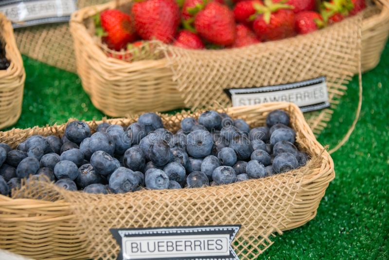 Baskets of Blueberries and Strawberries on Display royalty free stock images