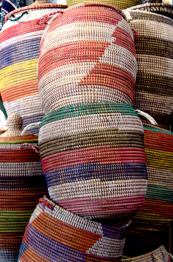 Baskets - fabric- handmade - colored. Colored baskets in outdoor market royalty free stock photography