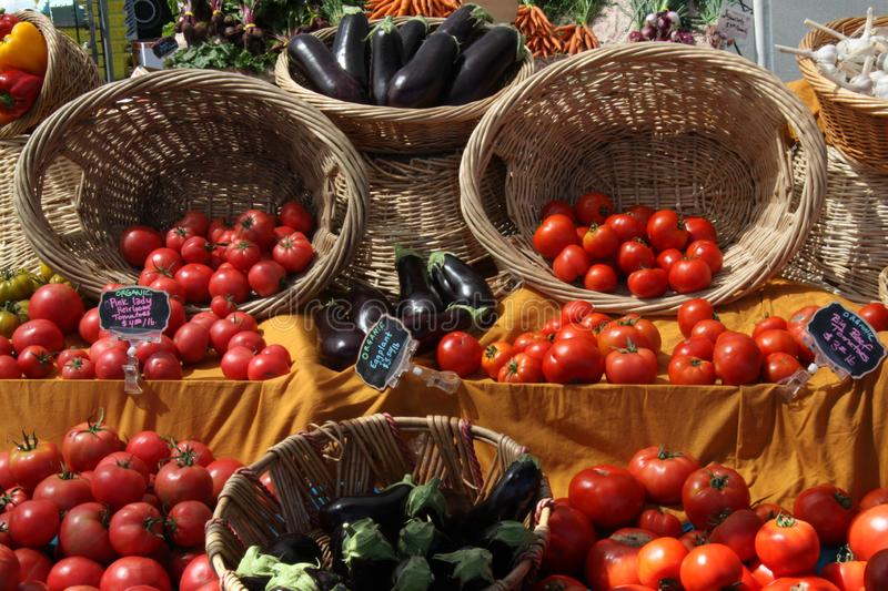 Baskets of fruit and vegetables at a market stock photo