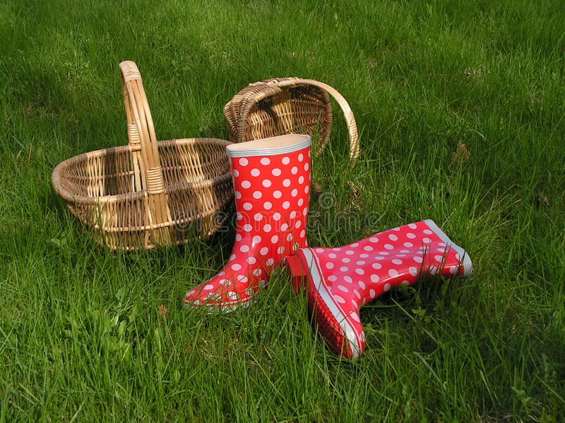 Baskets and gumboots stock photos