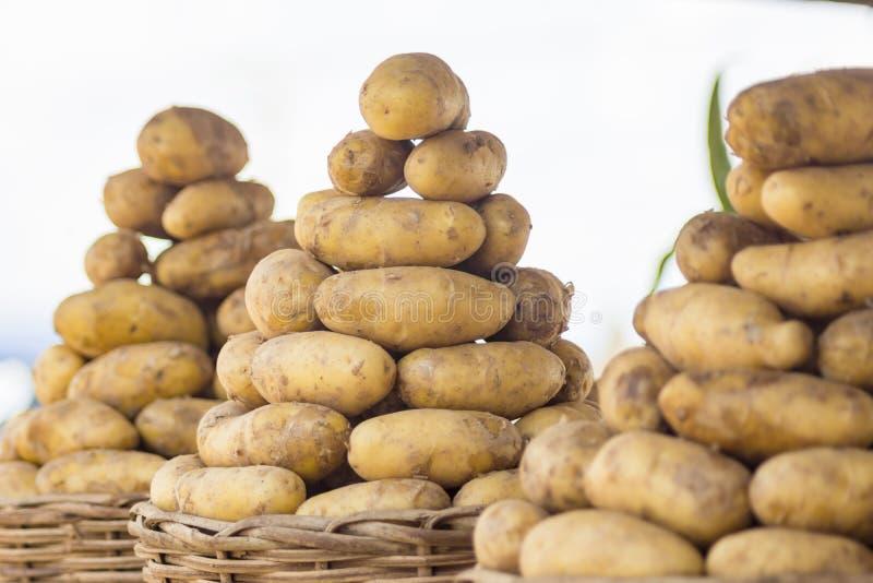 Baskets of potatoes stock photo