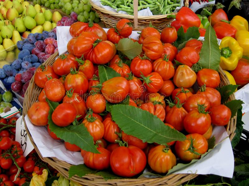 Baskets with red tomatoes / ox heart / and others vagitables stock photo
