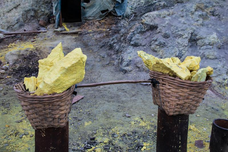 Baskets of sulfur ore mined from Mount Ijen, Indonesia. Baskets of sulfur ore mined from the crater of Mount Ijen, East Java, Indonesia royalty free stock photos