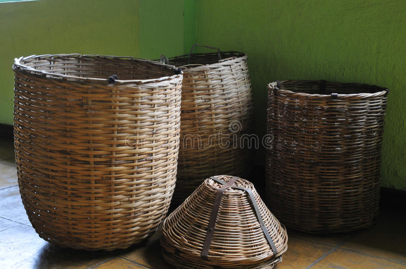 Baskets in tea farm. Baskets in front of a green wall of the Bois Cheri tea farm royalty free stock photography