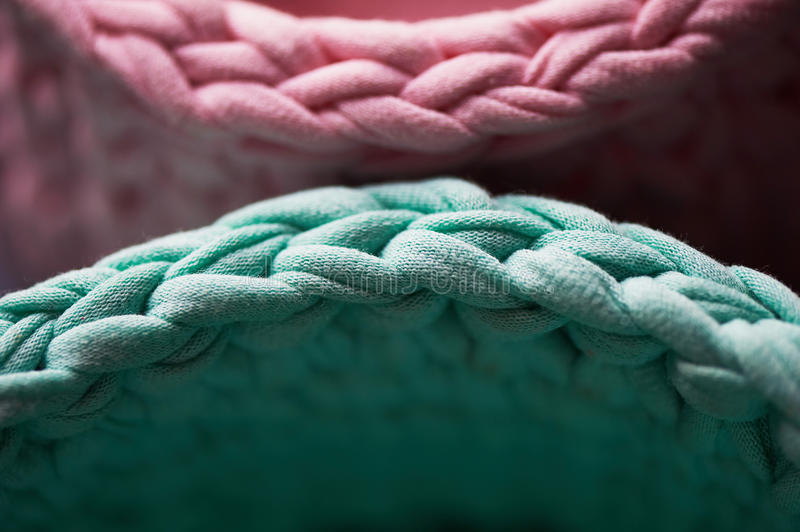 Baskets - turquoise and pink crochet around the circle of knitting yarn, made of cloth. Close. Baskets - turquoise and pink crochet around the circle of knitting royalty free stock image