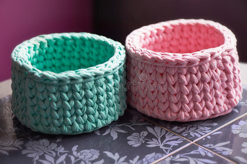 Baskets - turquoise and pink crochet around the circle of knitting yarn, made of cloth. Close. Baskets - turquoise and pink crochet around the circle of knitting stock images