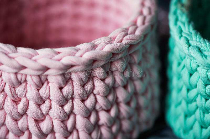 Baskets - turquoise and pink crochet around the circle of knitting yarn, made of cloth. Close. Baskets - turquoise and pink crochet around the circle of knitting stock photo