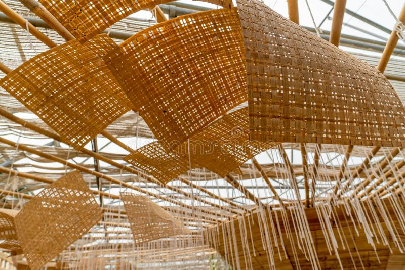 Basketwork made of bamboo used as decoration on the ceiling. Basketwork made of bamboo used as decorative items on the ceiling in a botanical garden stock photos