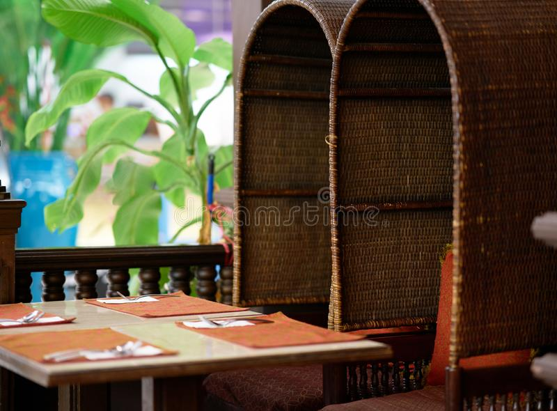 Basketwork or wickerwork Chairs and dining table for food meal. Thai style lanna stock images